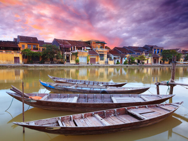 Hoi An Vietnam sunset traditional canoes